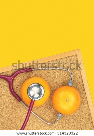 Stethoscope examining orange on a cork board. Medical equipment, Healthy food, Healthy eating concept. (Vintage Style Color) - stock photo