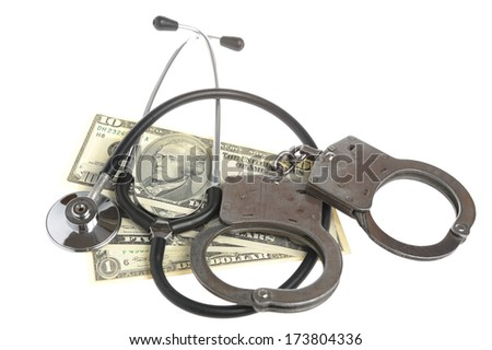 Stethoscope, handcuffs and money isolated - stock photo