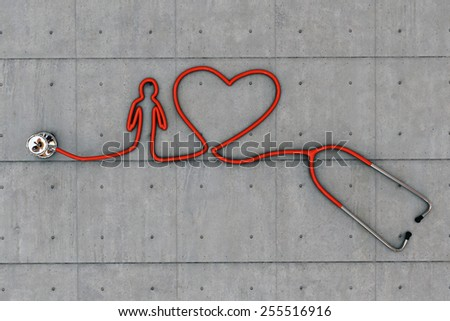 stethoscope heart shaped on concrete floor - stock photo