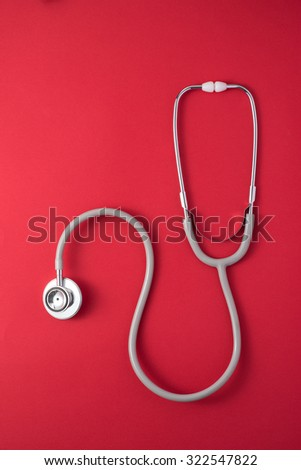 stethoscope isolated on red background. Medicine concept.