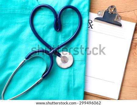 Stethoscope on a background of medical coat - stock photo