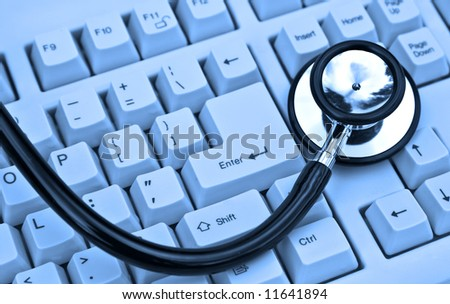 stethoscope on a keyboard in cool blue - stock photo
