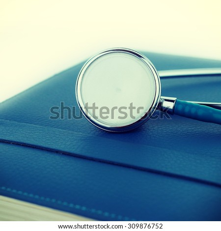 Stethoscope  on a notebook background-instagram filter - stock photo