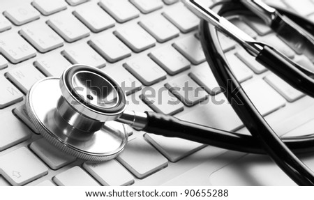 stethoscope on a white laptop computer - stock photo