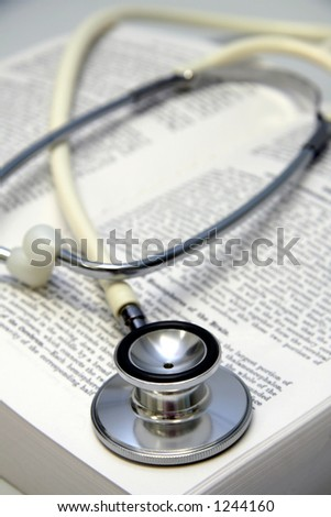 Stethoscope on an open medical book series - stock photo
