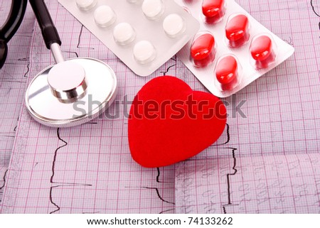 Stethoscope on ECG and tablets - stock photo