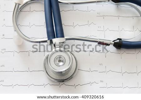 Stethoscope on electrocardiogram chart - stock photo
