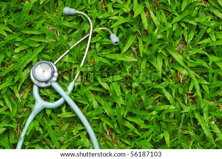 stethoscope on grass - stock photo