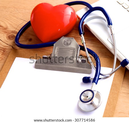 Stethoscope on laptop keyboard. Concept 3D image - stock photo