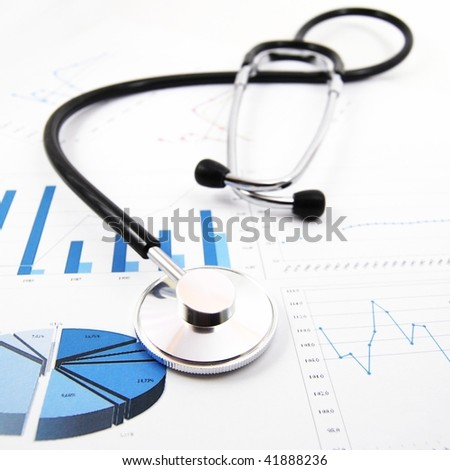 stethoscope on medical data chart in hospital