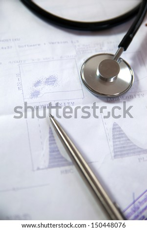 stethoscope on medical records - stock photo