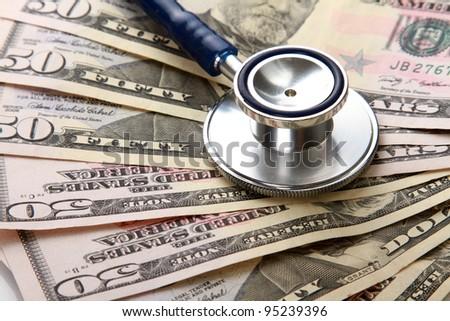 Stethoscope on money background - stock photo
