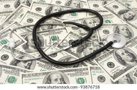 Stethoscope on money background - medical business concept - stock photo