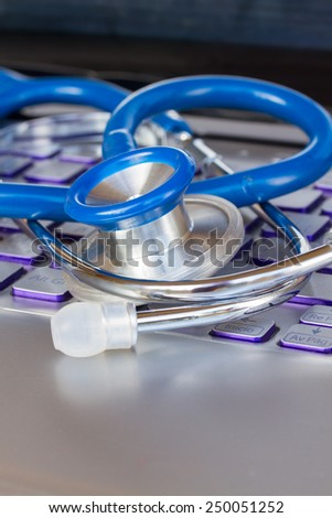stethoscope on notebook keyboard close up - modern medicine concept - stock photo