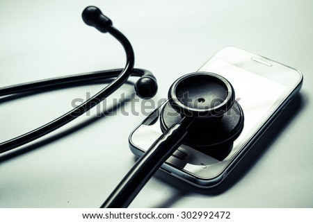 stethoscope on smartphone - checking security on smartphone concept - stock photo