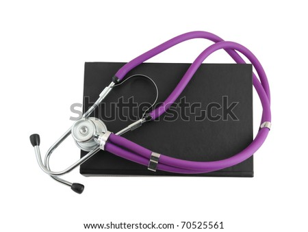 Stethoscope on the black medical  book isolated on white