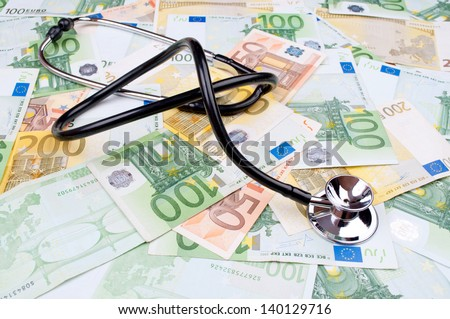 Stethoscope on the full frame of Euro money banknotes - stock photo
