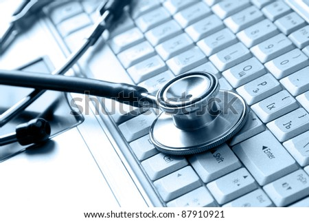 Stethoscope on the keyboard - stock photo