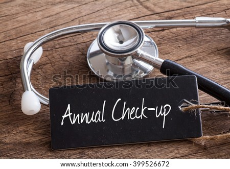 Stethoscope on wood with Annual Check-up word as medical concept - stock photo