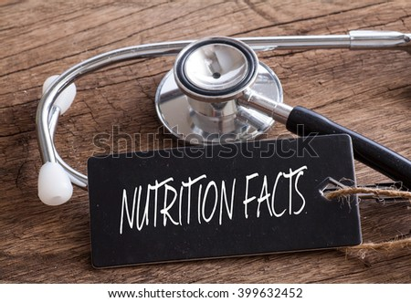 Stethoscope on wood with Nutrition Facts word as medical concept - stock photo