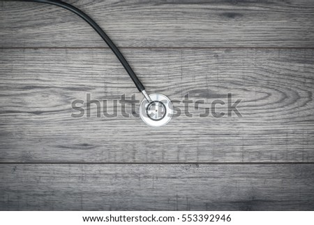 Stethoscope on wooden background. Medicine, health background concept.