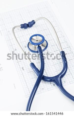 Stethoscope over ecg graph - stock photo