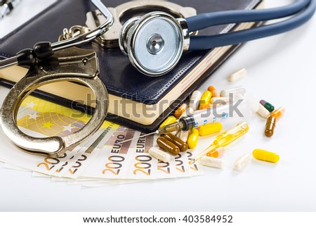 Stethoscope, pills and bottles on color background. medicine concept