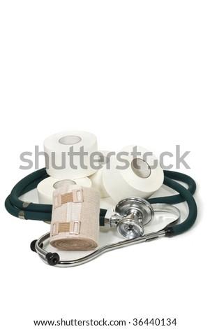 Stethoscope with bandages on white - stock photo
