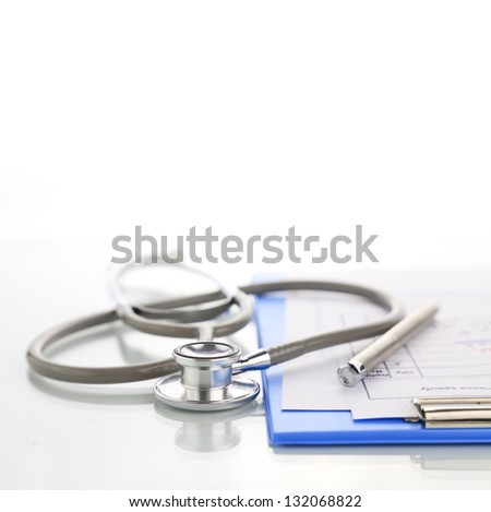 Stethoscope with blue medical clipboard - stock photo