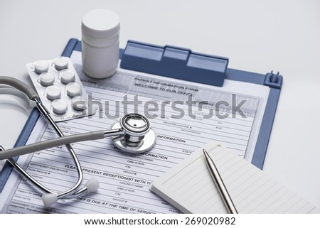 Stethoscope with blue medical clipboard. Medical concept - stock photo