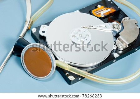 stethoscope with hdd on blue background - stock photo
