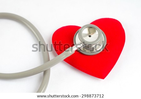 Stethoscope with red heart on white background - Health care concept - stock photo