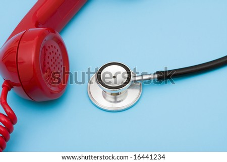 Stethoscope with telephone, help with your medical questions - stock photo