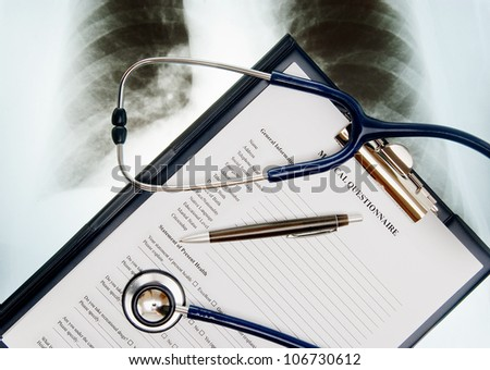 Stethoscope; Xray photo and medical questionnaire form - stock photo