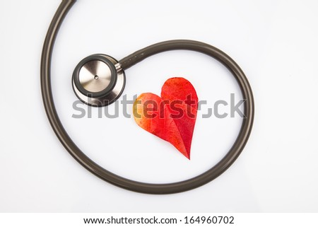 Stetoscope with a heart shaped leaf - stock photo
