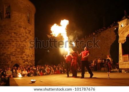 STETTENFELS, GERMANY - APRIL 30: Medieval fire show with fire dancers at the Castle Stettenfels on April 30, 2012 in Stettenfels, Germany. - stock photo