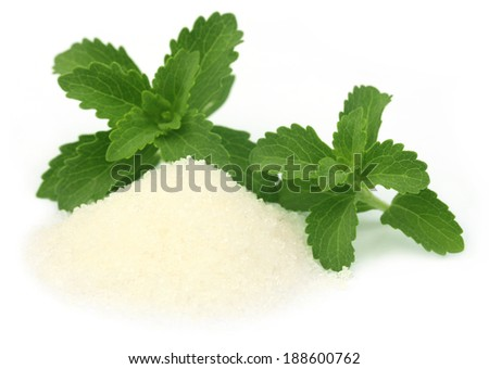 Stevia with sugar over white background - stock photo