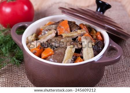 Stew in a ceramic pot - stock photo