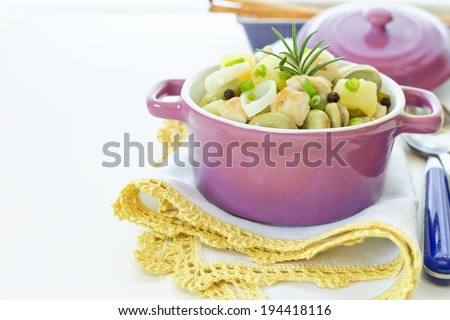Stew of chicken, potatoes, beans and rosemary - stock photo