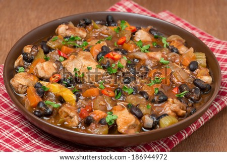stew with black beans, chili, chicken and vegetables, close-up, horizontal
