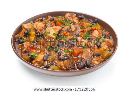 stew with black beans, chili, chicken and vegetables, isolated on white - stock photo
