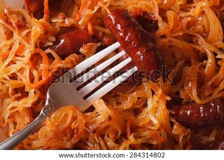 stewed cabbage with sausage macro. horizontal background - stock photo