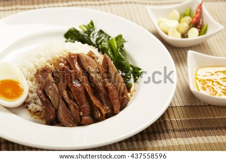 Stewed pork leg on rice with garlic and kale