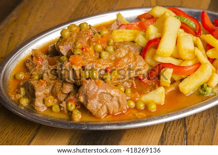 Stewed veal with vegetables and sauce - stock photo
