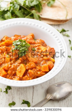 Stewed vegetables in a white bowl on the table