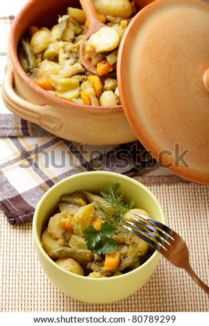 Stewed vegetables in pottery on table - stock photo