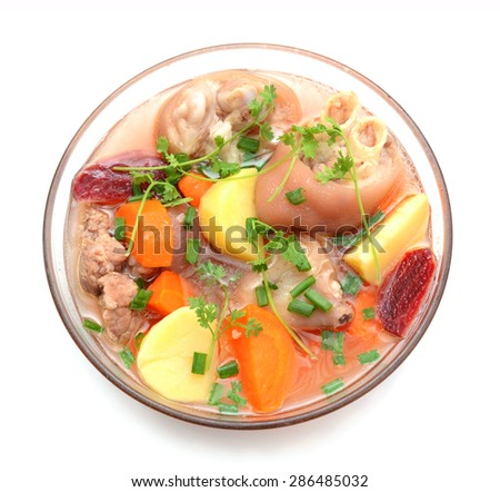Stewed vegetables with meat in old clay pot on a white background - stock photo