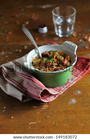 Stewed white cabbage with sausages and lentil - stock photo