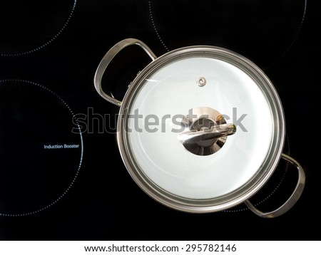 Stewpot on black induction cooker shot from above - stock photo