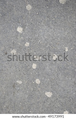 Sticked chewing gums on sidewalk - stock photo